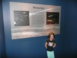 Maddie at the Tellus Museum meteorite exhibit