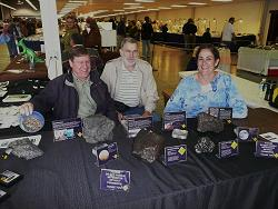 Wayne, RJ and Anita exhibiting a few meteorites at a local show